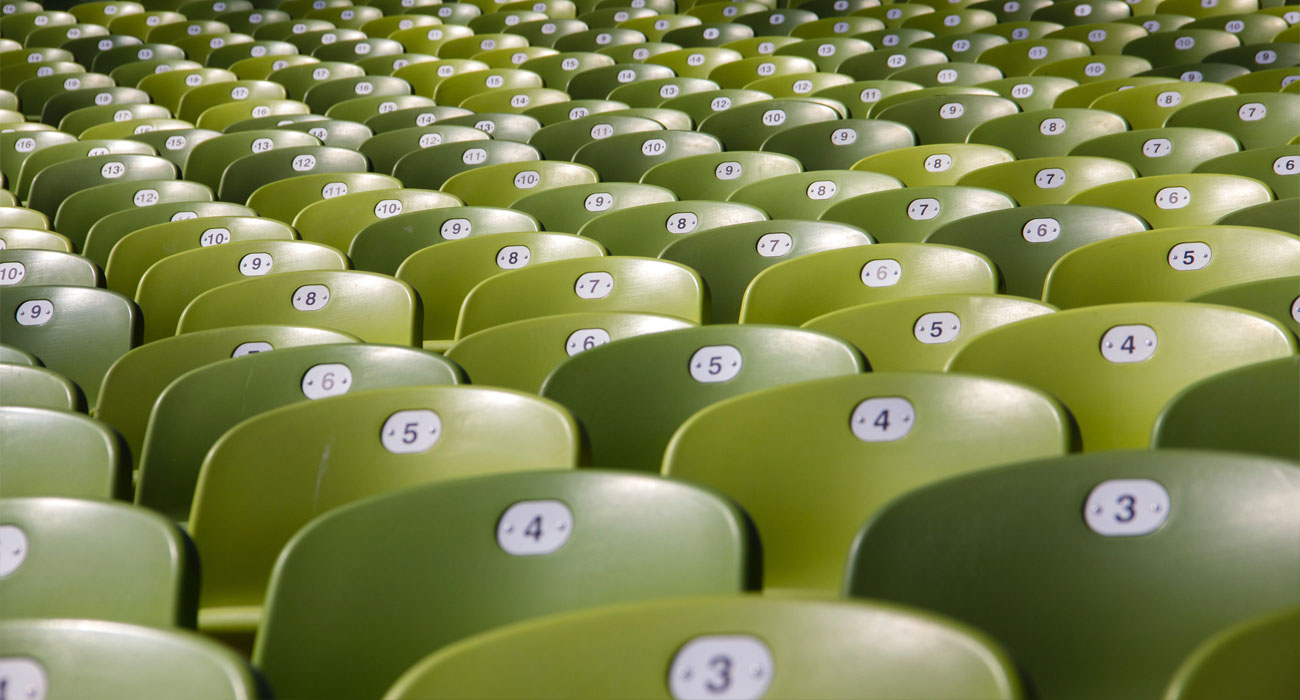 Back of chairs with numbers in green